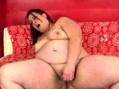 Redhead BBW babe satisfies herself with toys