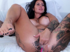 Tattooed big ass busty MILF dildoing plus squirting on webcam